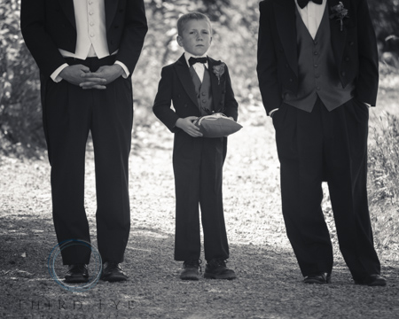 Ring bearers and flower girls should match the wedding party in some way.